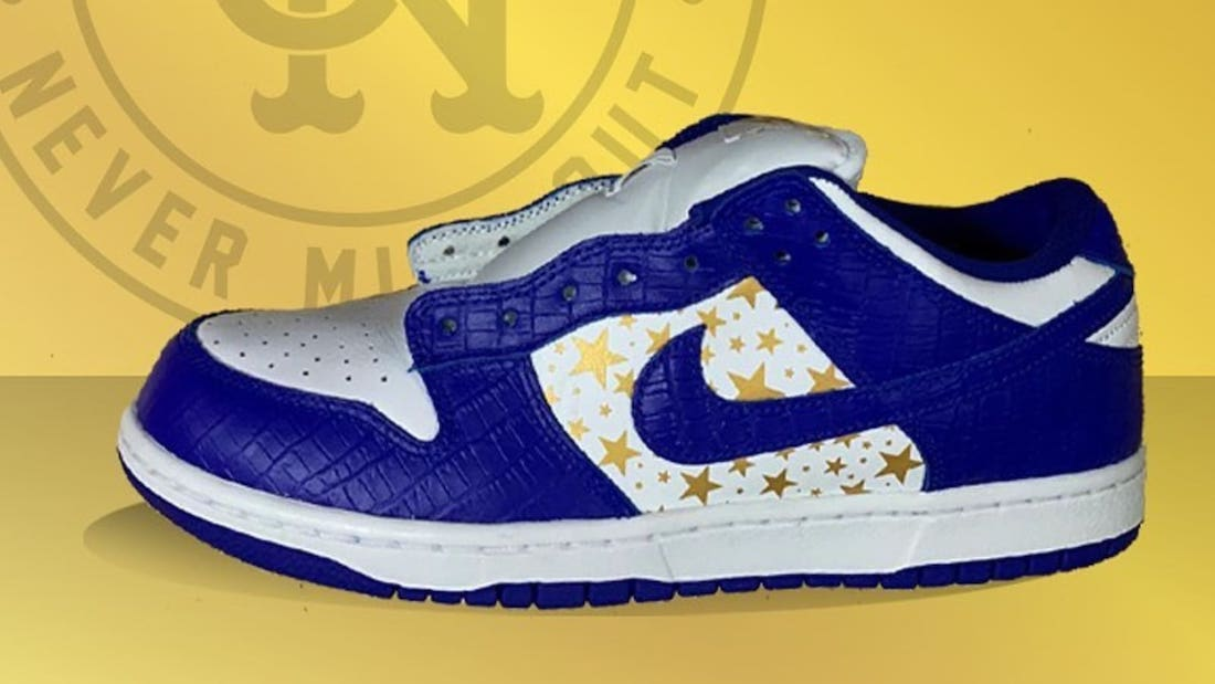 Photo de la sneaker Supreme x Nike SB Dunk Low White/Metallic Gold-Hyper Blue